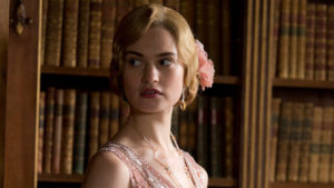 316063-downton-abbey-lady-rose-looks-caught-up-in-something